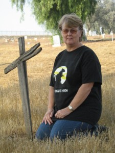 kathy beside the cross 225x300 Monster Moon Week: Author Interview BBH McChiller, Curse at Zala Manor