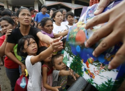 typhoon victims queue for supplies A Plea for Victims of the Philippine Typhoon Sendong