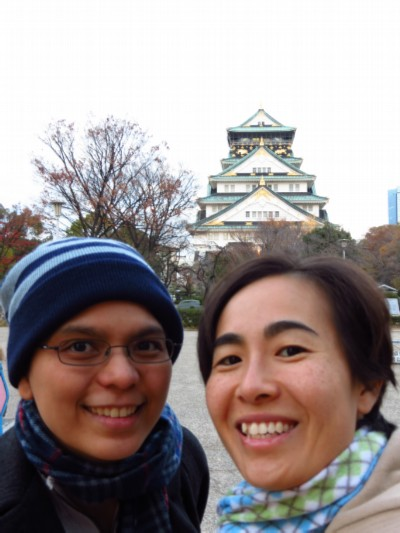 maiko and i in front of castle building Japan: Osaka Castle